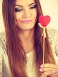 Beautiful woman holding heart shaped hand stick Stock Image