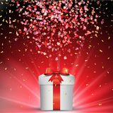 Valentine`s day gift with falling confetti Stock Photos