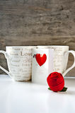 Valentine's day gift with greeting card and two cups. Valentine's day gift box with greeting card and two cups on wooden background. Close-up Stock Images
