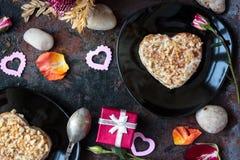 Valentine's day gift on hotel restaraunt. On black table royalty free stock photo
