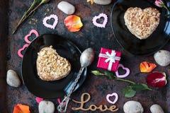Valentine's day gift on hotel restaraunt. On black table stock photos