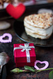 Valentine's day gift on hotel restaraunt. On black table stock photo
