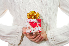 Valentine's Day gift in palms of hands Royalty Free Stock Photo