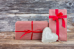 Valentine's Day gifts with heart on wooden background. Toned, soft focus, copy space. Two Valentine's Day gifts with heart on wooden background. Toned, soft Stock Photography