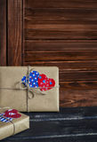 Valentine's day gifts in kraft paper, paper hearts on  wooden surface. Vintage and rustic style Stock Images