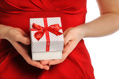 Valentine\'s Day: Giving Gift with Red Ribbon Stock Images