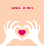 Valentine's day greeting card. Two hands with a heart Stock Image
