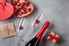 Valentine`s day greeting card with champagne glasses and candy hearts on stone background. Top view with space for your greetings stock photo
