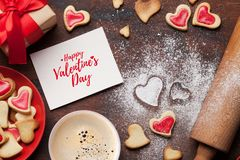 Valentine`s day greeting card. With cooking heart shaped cookies on wooden background. Top view with space for your greetings. Flat lay stock photos