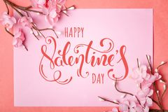 Valentine`s day. Greeting card on coral background.Selective focus. Horizontal. Top view stock images