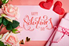 Valentine`s day. Greeting card on coral background.Selective focus. Horizontal. Top view royalty free stock images