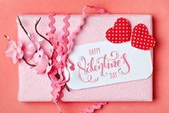 Valentine`s day. Greeting card on coral background.Selective focus. Horizontal. Top view stock photos