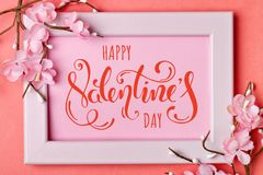 Valentine`s day. Greeting card on coral background. Selective focus. Horizontal. Top view stock image