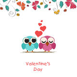 Valentines Day greeting card with owls couple. Happy Valentines Day celebration concept with cute owls couple in love and red hearts Royalty Free Stock Photos
