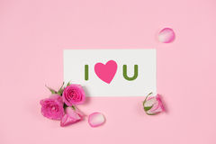 Valentine`s Day greeting card with rose flowers over wooden back royalty free stock photography