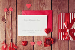 Valentine's day greeting card template with heart shape chocolate and gift box. View from above Royalty Free Stock Images