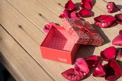 Valentine`s Day greeting card . Top view on romantic composition with gift box copy space on wooden background. Valentine`s Day greeting card. Top view on stock image