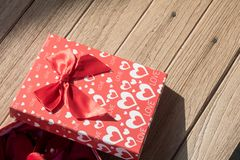 Valentine`s Day greeting card. Top view on romantic composition with gift box copy space on wooden background. Top view on romantic composition with gift box royalty free stock photo