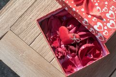 Valentine`s Day greeting card. Top view on romantic composition with gift box copy space on wooden background. Top view on romantic composition with gift box stock image