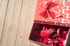 Valentine`s Day greeting card . Top view on romantic composition with gift box copy space on wooden background. Valentine`s Day greeting card. Top view on royalty free stock images