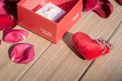 Valentine`s Day greeting card . Top view on romantic composition with gift box copy space on wooden background. Valentine`s Day greeting card. Top view on royalty free stock photo