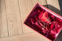 Valentine`s Day greeting card . Top view on romantic composition with gift box copy space on wooden background. Valentine`s Day greeting card. Top view on stock images
