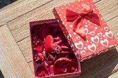 Valentine`s Day greeting card . Top view on romantic composition with gift box copy space on wooden background. Valentine`s Day greeting card. Top view on stock photography