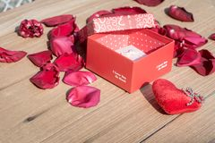 Valentine`s Day greeting card . Top view on romantic composition with gift box copy space on wooden background. Valentine`s Day greeting card. Top view on stock photo