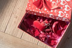 Valentine`s Day greeting card . Top view on romantic composition with gift box copy space on wooden background. Valentine`s Day greeting card. Top view on stock photos