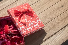 Valentine`s Day greeting card. Top view on romantic composition with gift box copy space on wooden background. Valentine`s Day greeting card. Top view on royalty free stock photo