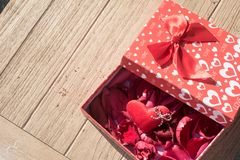 Valentine`s Day greeting card. Top view on romantic composition with gift box copy space on wooden background. Valentine`s Day greeting card. Top view on stock photo