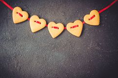 Free Valentine`s Day Greeting Card With Gingerbread Cookies In The Shape Of A Heart Stock Image - 135984761