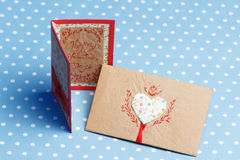 Valentine's day handmade love message. Card and envelope, vintage style, isolated on blue with white dots (polka dot) background Royalty Free Stock Images