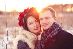 Valentine's day happy couple. Cheerfull young lovers are smiling and hugging in sunlight Royalty Free Stock Photography