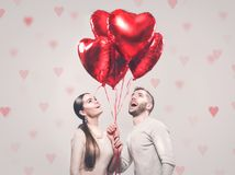 Valentine`s Day. Happy joyful couple. Portrait of smiling beauty girl and her handsome boyfriend stock photo