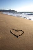 Valentine\'s Day heart on the beach in italy. With nice waves Stock Image
