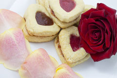 Valentine`s Day Heart Cookies with rose petals Stock Images