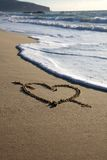 Valentine\'s Day heart with cross on the beach Royalty Free Stock Photography