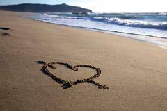 Valentine\'s Day heart with cross on the beach. Horizontal Royalty Free Stock Images