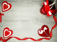 Valentine`s day heart gift box and sweet lollipop. Love valentine`s day heart gift box teddy lollipop and greeting card with copy space Stock Image