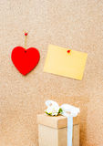Valentine's day heart, gift box and yellow empty card on wooden Royalty Free Stock Image