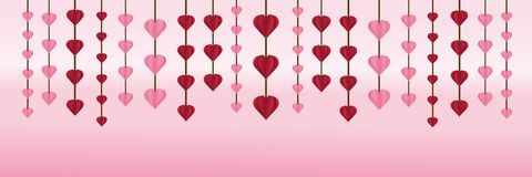 Valentine`s Day is heart hanging on the wallpaper . Stock Photo