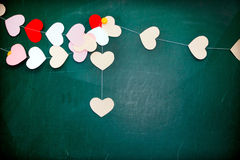 Valentine's day. Heart of paper hanging on blackboard background Royalty Free Stock Photo