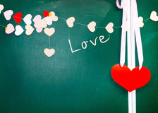 Valentine's day. Heart of paper hanging on blackboard background Royalty Free Stock Image