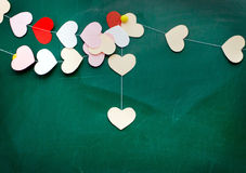 Valentine's day. Heart of paper hanging on blackboard background Stock Photos
