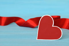 Valentine's Day heart and red ribbon Stock Photography