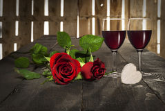 Valentine's day heart roses and red wine. Roses for Valentine's day, wood background, wine Stock Photography