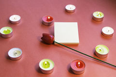 Valentine`s Day. Heart shaped candles with stickers and flower. stock photo