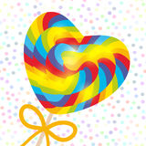 Valentine`s Day Heart shaped candy lollipop with bow, bright rainbow stripes, colorful spiral candy cane. on stick with twisted de Stock Photo