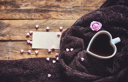 Valentine`s day, heart shaped coffee cup, cozy brown scarf Stock Images